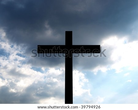Christian Cross over dark sky