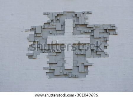 Christian Cross Sign On brick Wall - stock photo