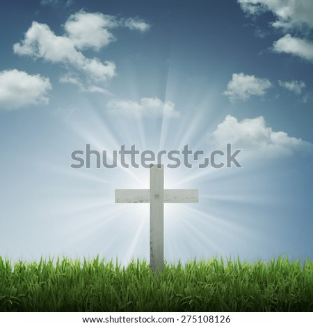 Christian cross with blue sky and cloud background. With ray of light effect - stock photo