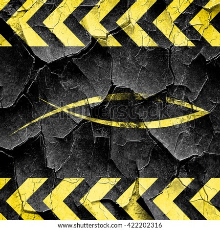 Christian fish symbol, black and yellow rough hazard stripes