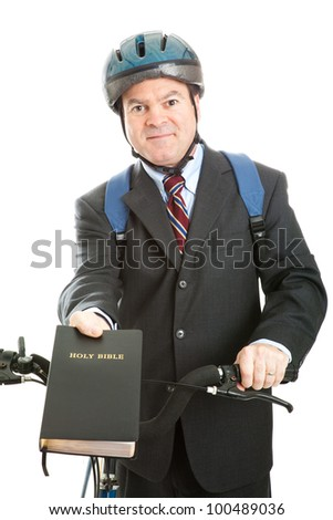 Christian missionary with his bible and bicycle.  Isolated on white - stock photo