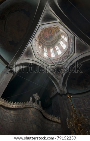Christian orthodox church interior with ray of light in Romania, Brebu - stock photo