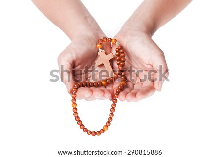 Christian prayer beads in the hand of woman  - stock photo