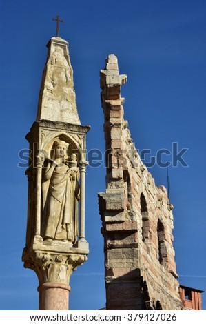 Christian shrine with Mary and Verona Arena outer ring in the background, in the center of Verona - stock photo