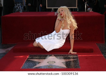 Christina Aguilera at Christina Aguilera's induction into the Hollywood Walk of Fame, Hollywood Blvd, Hollywood, CA. 11-15-10 - stock photo