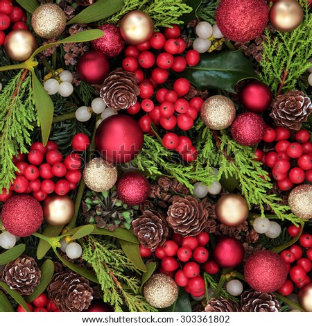 Christmas abstract background with red bauble decorations, holly, ivy, mistletoe, blue spruce fir and cedar cypress greenery. - stock photo