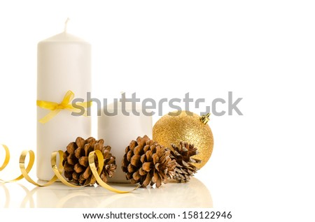 Christmas abstract decoration of candles, pine cones and gold Christmas bauble isolated on white - stock photo