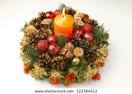 Christmas advent wreath on the table with the white background. - stock photo