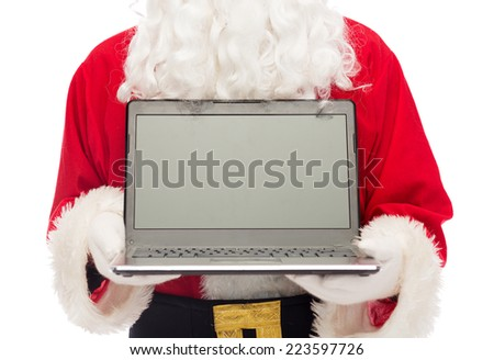 christmas, advertisement, technology, and people concept - close up of santa claus with laptop computer - stock photo