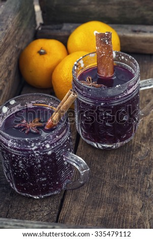 Christmas alcoholic drink.Crystal goblet with mulled wine and cinnamon stick in it,decorated with star anise - stock photo