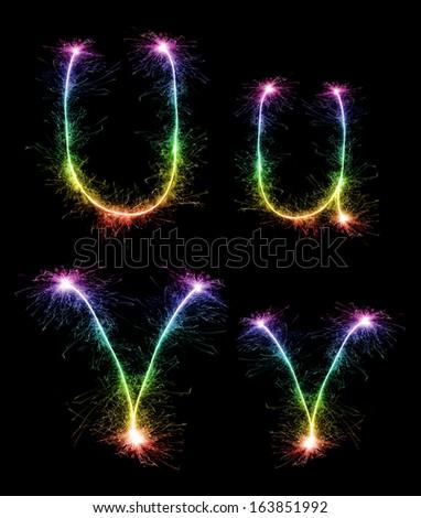 Christmas alphabet created a sparkler,letter u,letter v - stock photo