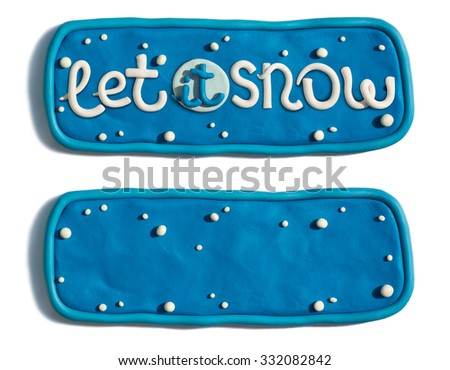 Christmas and New Year banner handmade of plasticine. Let it snow lettering on decorated banner. - stock photo