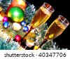 Christmas and New Year decoration- balls, tinsel, candel  and glasses of champagne .On black background - stock photo