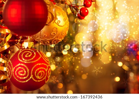 Christmas and New Year Decoration. Bauble hanging on Christmas Tree. Holiday Glowing Background. Shallow DOF  - stock photo
