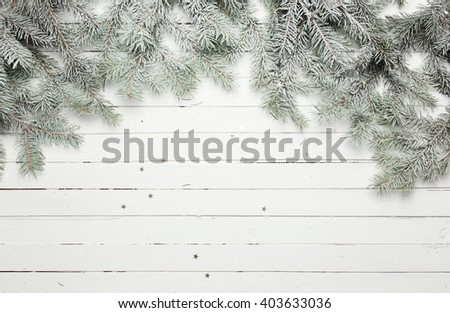 Christmas and New Year decoration composition. Top view of fur-tree branches on wooden background with place for your text - stock photo