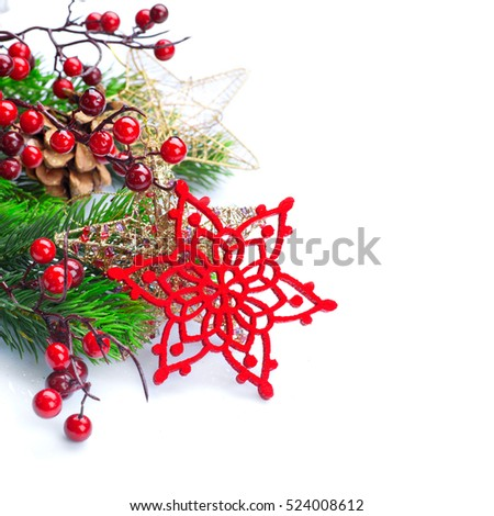 Christmas and New Year Decoration isolated on white background. Border art design with holiday baubles. Beautiful Christmas tree closeup decorated with red Snowflake, holly berry, tinsel. Copy space