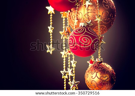 Christmas and New Year decorations border Design. Hanging Christmas Baubles and Garland over dark background - stock photo