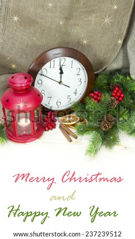 Christmas and New Year Decorations on flax background.Lantern light, clock and tinsel  - stock photo