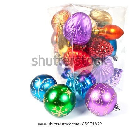 Christmas and new-year decorations. Varicoloured christmas balls in a box, on white background. - stock photo