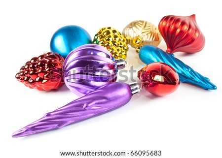 Christmas and new-year decorations. Varicoloured christmas toys and balls on white background - stock photo