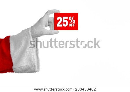 Christmas and New Year discounts topic: Santa's hand holding a red card for a 25 percent  discount on an isolated white background - stock photo