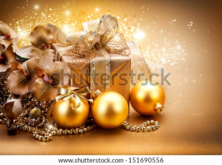 Christmas and New Year Gift and Decorations. Golden Baubles, Gift Box and Garland