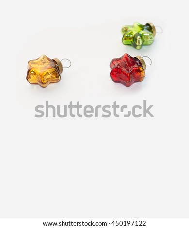 Christmas and new year red, gold and green toys. Glassy vintage stars on a light background - stock photo