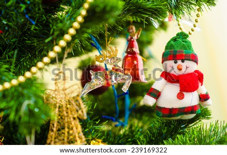 Christmas and New Year's toys on the Christmas tree - stock photo