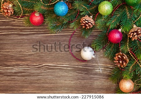 Christmas and New Year tree with decorations on brown wooden background