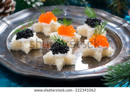 Christmas appetizers with caviar on a plate, close-up, horizontal - stock photo