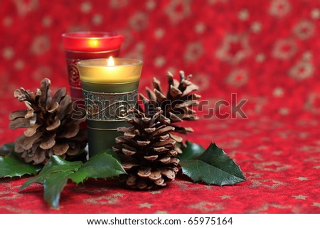 Christmas arrangement with candles and cones on red background. Shallow dof - stock photo