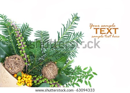 Christmas arrangement with pine tree branches and decorations. - stock photo