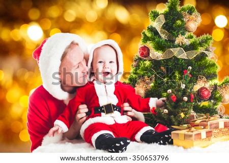 Christmas baby and mom under the fir tree  - stock photo