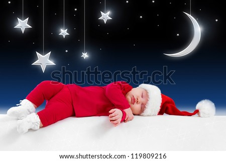 Christmas baby is sleeping on background fairy-tale night - stock photo