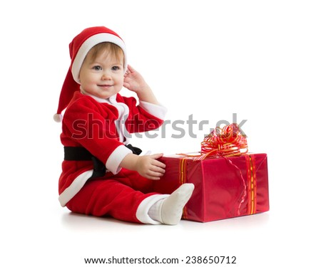 Christmas baby with box in Santa's clothes isolated - stock photo