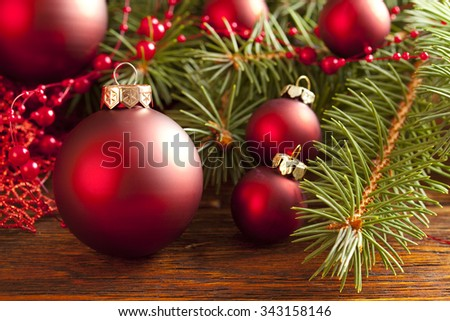 Christmas background - baubles and branch of spruce tree - stock photo