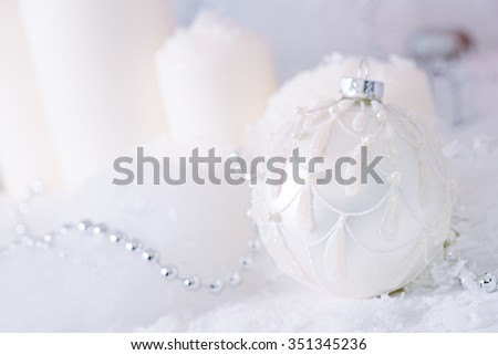 Christmas background: beautiful christmas ball in the snow.  - stock photo