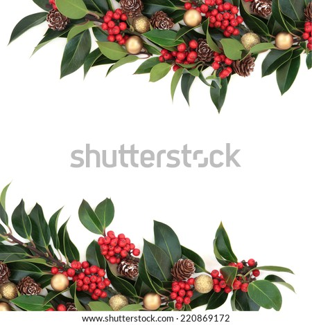 Christmas background border decoration with holly, baubles and pine cones over white background. - stock photo