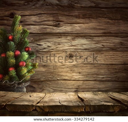 Christmas background. Empty table for your montage. Xmass tree on wood. Space for text