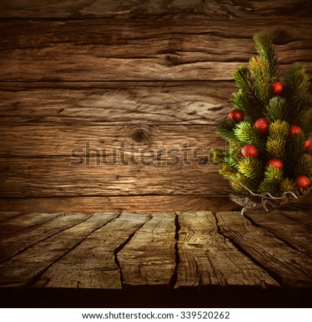 Christmas background. Empty table for your montage. Xmass tree on wood. Space for text  - stock photo