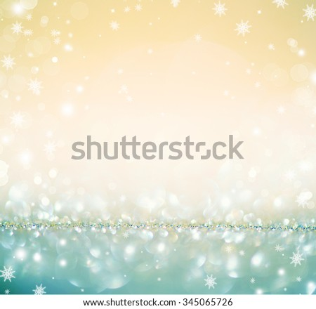 Christmas Background. Golden Holiday glowing Abstract Glitter Defocused Background With Blinking Stars and snowflakes. Blurred Beige and Blue color Bokeh  - stock photo