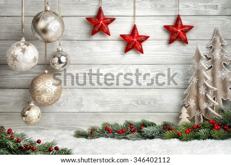 Christmas background in bright wood style, modern, simple and elegant, with a border of baubles, fir branches, stars, ornamental trees and snow - stock photo