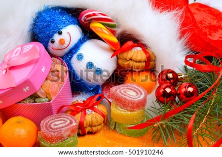 Christmas background, lollipops, pine twig, sweets, jellies and snowman.