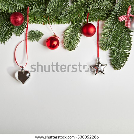 Christmas Background made of Natural Winter Branch and Christmas Decoration. Flat lay.