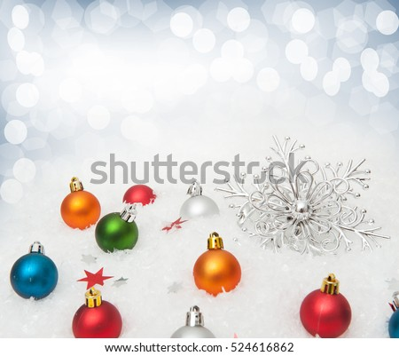 Christmas background. Multicolored Christmas ornaments, snowflake in snow.  light reflections