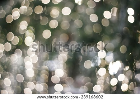 Christmas background of de-focused lights with decorated tree - stock photo