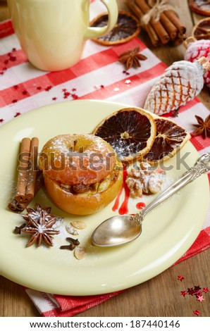 Christmas background of homemade oven baked apples stuffed with cottage cheese, pumpkin seeds and almonds served on plate