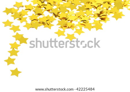 Christmas background of scattered glittering stars confetti isolated on white background - stock photo