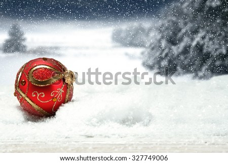 christmas background of snow ice and frost with landscape of park and one red ball  - stock photo