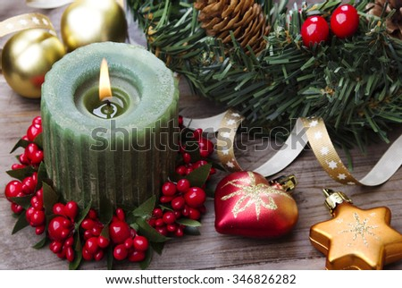 Christmas background, rustic style candle and baubles